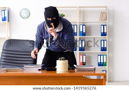 Male thief in balaclava in the office  #1419365276