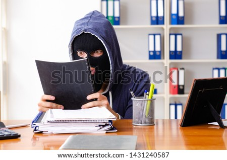 Male thief in balaclava in the office  #1431240587