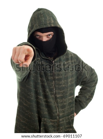 male thief in mask and hood pointing you