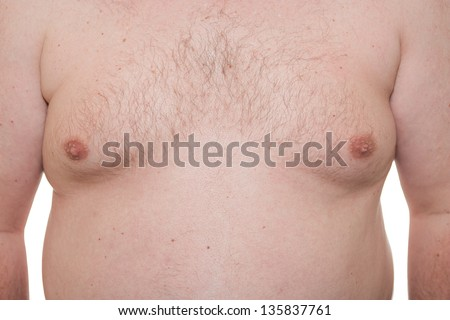 Male thorax showing early stage Gynecomastia or man boobs also a symptom of obesity