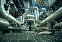 Male to be worker visual inspection inside control room valve and pipeline power plants