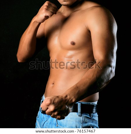 Male torso and hands clenched in a fist