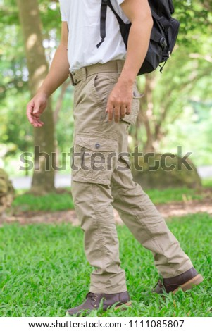 male tourist in the park. Tourism and travel concept, cargo pants #1111085807
