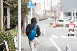 Male tourist walking around city in kumamoto city japan.