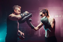 male trainer gives self-defense classes to female fighter - uppercut long, boxing, training