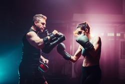 male trainer gives self-defense classes to female fighter - uppercut short, boxing, training