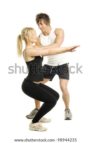 Male trainer instructing woman isolated on a white background