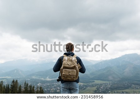 Male traveler from back in the mountains #231458956