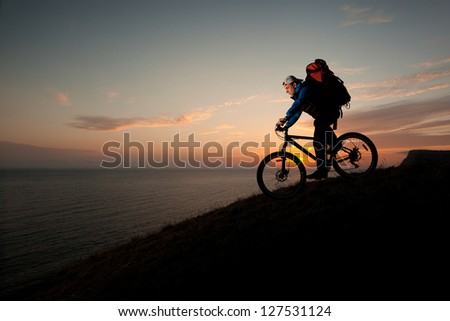 male traveler heading off the evening with a mountain bike