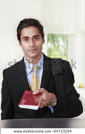 Male traveler shows passport at counter
