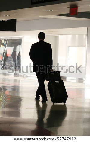 male traveler walking in airport