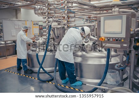 Male two work the process of cream cosmetic fermentation at the manufacturing with stainless tank on the background Photo stock ©