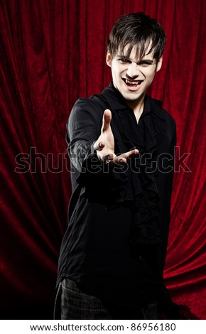 Male vampire with stretched out hand.