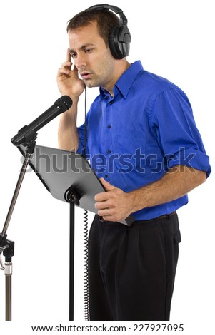 male voice over artist or singer on a microsphone wearing a blue shirt on a white background