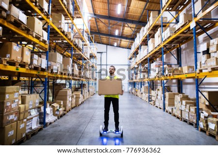 Male warehouse worker on hoverboard. #776936362