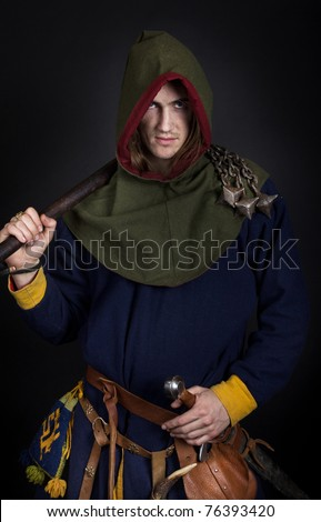 Male wearing a cloak and holding club