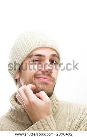 Male with hat giving a distrust look. Space for text
