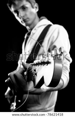 male with red elegtric guitar, playing solo