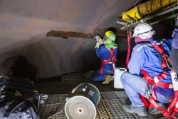 Male worker inside safety harness wear storage visual inspection tank into the confined space