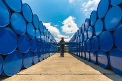 Male worker inspection record drum oil stock barrels blue horizontal or chemical for in industry