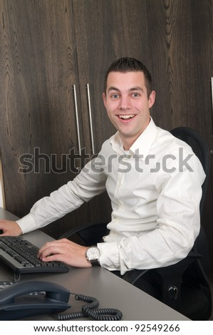 Male working at a computer in an office