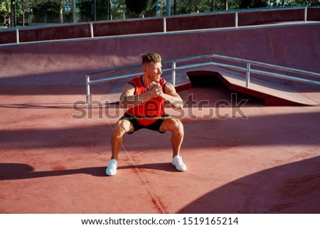 male young athlete outdoor athlete handsome athlete doing exercises