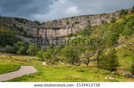Malham Cove is a limestone formation in Yorkshire Dales National Park, England. It was formed by a waterfall carrying meltwater from glaciers at the end of the last Ice Age more than 12,000 years ago #1539413738