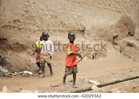 MALI - AUGUST 17: Children playing in a street in Djenne, in Djenne the population belonging to ethnic Peul, Dogon and Bambara, August 17, 2009 in Djenne, Mali