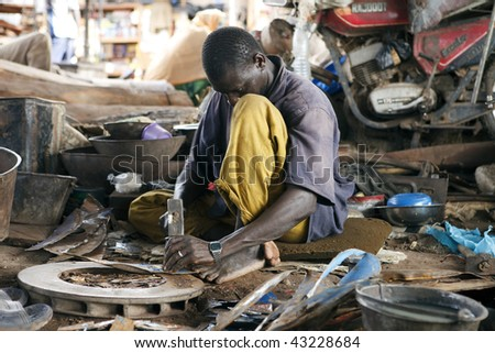 MALI - AUGUST 16: Man working at the port of Mopti, the port provides employment for much of the population, since it is the nation's largest, August 16, 2009 in Mopti, Mali