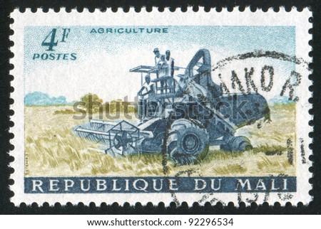 MALI - CIRCA 1961: A stamp printed by Mali, shows Harvester, circa 1961