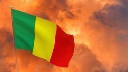 Mali flag on pole. Dramatic background. National flag of Mali