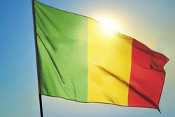 Mali flag waving on the wind in front of sun