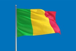 Mali national flag waving in the wind on a deep blue sky. High quality fabric. International relations concept.