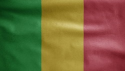 Malian flag waving in the wind. Close up of Mali banner blowing, soft and smooth silk. Cloth fabric texture ensign background. Use it for national day and country occasions concept.