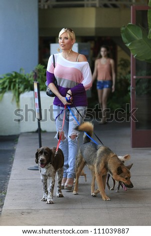 "MALIBU - AUG 24: Ariane Bellamar who currently stars  in ABC Family's ""Beverly Hills Nannies"" is out with her four dogs on August 24, 2012 in Malibu, California"