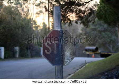 MALIBU - NOV 25: Burnt stop sign in a Malibu neighborhood as a result of a massive fire in Malibu, CA on November 25, 2007.