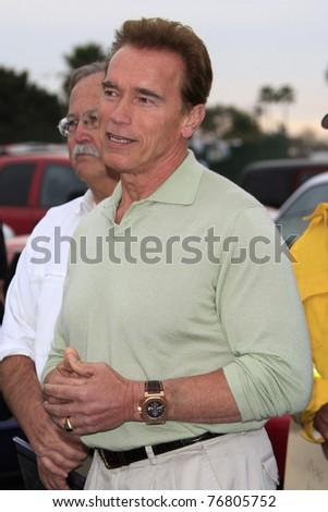 MALIBU - NOV 25: Governor Arnold Schwarzenegger arrives at a fire inspection in Malibu, CA on November 25, 2007. - stock photo