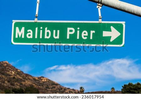 Malibu Pier Street Sign. A street sign on the Pacific Coast Highway indicating Malibu Pier in Malibu, California.