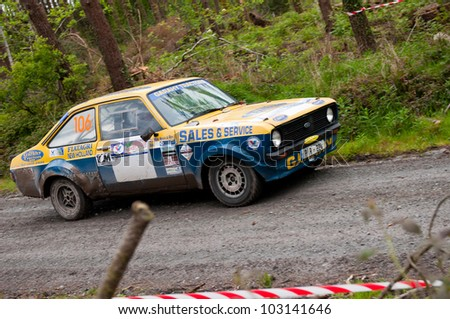 MALLOW, IRELAND - MAY 19: M. Nevin driving Ford Escort at the Jim Walsh Cork Forest Rally on May 19, 2012 in Mallow, Ireland. 4th round of the Valvoline National Forest Rally Championship.
