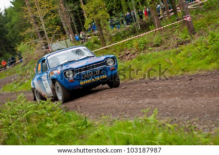 MALLOW, IRELAND - MAY 19: M. Sheahan driving Ford Escort at the Jim Walsh Cork Forest Rally on May 19, 2012 in Mallow, Ireland. 4th round of the Valvoline National Forest Rally Championship.
