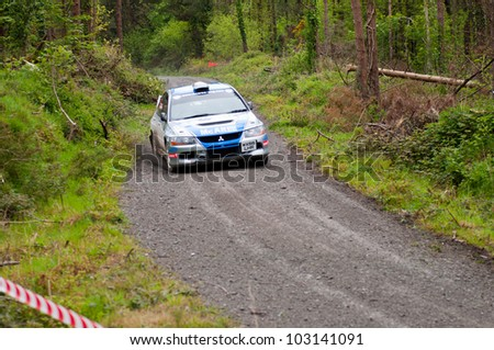 MALLOW, IRELAND - MAY 19: V. Mcaree driving Mitsubishi Evo at the Jim Walsh Cork Forest Rally on May 19, 2012 in Mallow, Ireland. 4th round of the Valvoline National Forest Rally Championship.