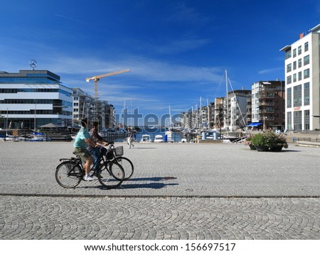 MALMO, SWEDEN - AUGUST 7 : Yachts and modern houses in marina on August 7, 2013 in a gulf of Malmo, Sweden.