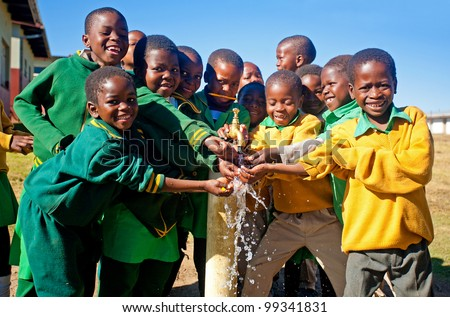 MALOLOTJA, SWAZILAND-JULY 31: Unidentified Swazi schoolboys on July 31, 2008 in Malolotja Government School, Malolotja, Swaziland. Close to 10% of Swazilandâ's population are orphans, due to HIV/AIDS.