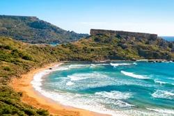 Malta beach. Beautiful sand beach. Ghajn tuffieha bay in summer. Tropical resort. Summer landscape with sea surf.