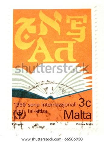 MALTA - CIRCA 1990: A stamp printed in Malta shows image of an open book, circa 1990