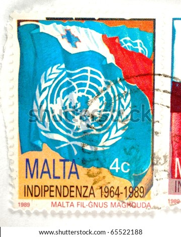MALTA - CIRCA 1989: a stamp printed in Malta shows the UN logo and celebrates 25 years of Maltese independence, circa 1989 - stock photo