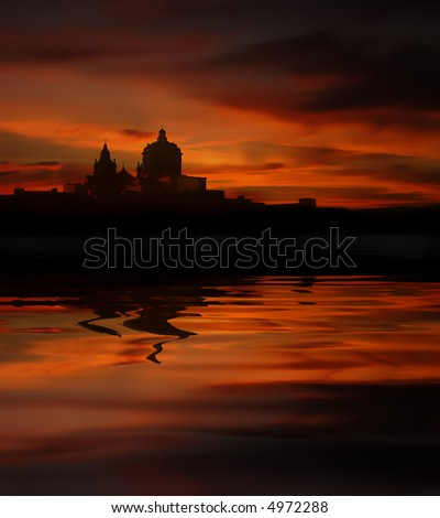 malta island at sunset with water reflection
