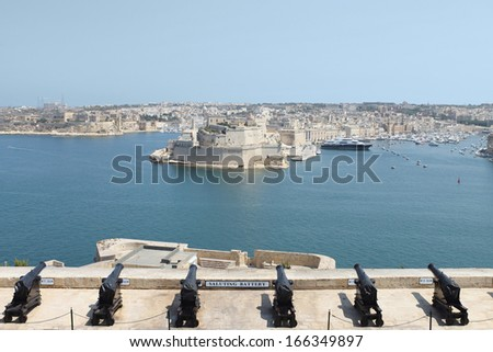 Malta, La Valletta amazing fortified city. Scenic view of the Grand Harbour, Fort St. Angelo and Birgu (Citta Vittoriosa) waterfront, from the British saluting battery in the Upper Barrakka gardens.