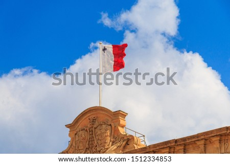 Malta national flag is waving in deep blue sky background #1512334853