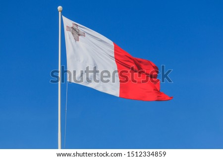 Malta national flag is waving in deep blue sky background #1512334859